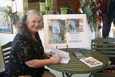 Author Amelia Painter signs her books at Annual event