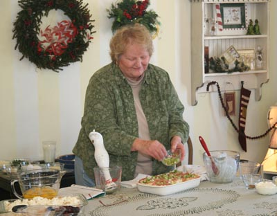 Donna Muilenburg giving cooking lesson at the 29th University of Okoboji Winter Games